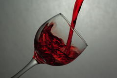 Wine pour 2. Wine pouring into a glass royalty free stock images