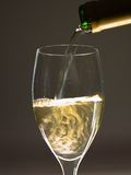 Wine Poured. Wine is being poured to a glass from a bottle Royalty Free Stock Photos