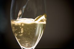 Wine Poured. Wine is being poured to a glass from a bottle Stock Photography