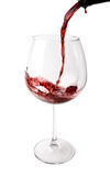Wine Poured into Big Glass. Wine Poured into Glass isolated on white Royalty Free Stock Photography