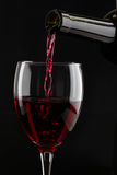 Wine is poured into a glass Royalty Free Stock Image