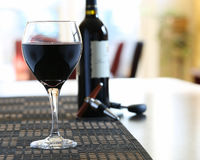 Wine poured in glass at home Stock Images