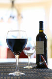 Wine poured in glass at home. Home comforts -  wine poured in glass, in kitchen Royalty Free Stock Photos