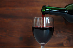 Wine is poured into a glass Royalty Free Stock Images