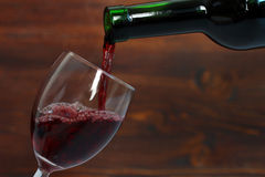 Wine is poured into a glass Stock Photography