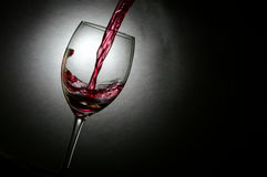 Wine poured into a glass Royalty Free Stock Photos