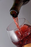 Wine is poured into a wine glass Royalty Free Stock Photo