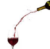 Wine pouring from bottle into glass Stock Image