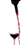 Wine pouring from bottle into glass Stock Photography