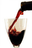 Wine pouring from bottle into a glass. Stock Photography