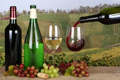 Wine pouring from a bottle into a wine glass Stock Images