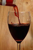 Wine pouring into glass Royalty Free Stock Photos