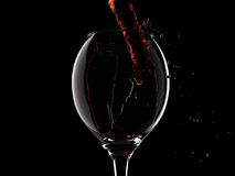 Wine pouring into glass closeup Stock Photo