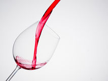 Wine pouring into a wineglass Royalty Free Stock Image