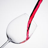 Wine pouring into a glass in square composition Royalty Free Stock Image
