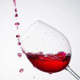 Wine pouring into a glass in square composition Stock Photos