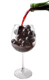 Wine pouring on grapes Royalty Free Stock Image