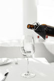 Wine. Pouring Red Wine From Bottle Into Wine Glass. Drinks. Stock Photography