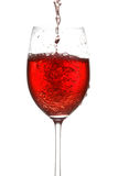 Wine pouring into wineglass Stock Images