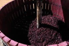 Wine press with red grape pomace. Manual wine press with red grape pomace pulp Royalty Free Stock Photos