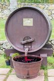 Fountain barrel. On the wine-producing farm, and in the garden has a barrel fountain,  which gushes water and the color of water and wine color stock photo