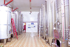 Wine production. Stainless steel barrels for wine storage, photography Royalty Free Stock Image