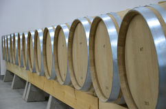 Wine Production. A modern wine cellar with barrels Stock Photos