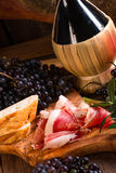 Wine and prosciutto Stock Image