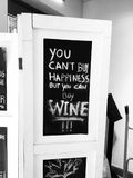 Wine quotes. You can't buy happiness, but you can buy good wine stock image
