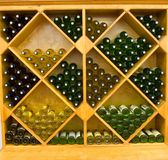 Wine Rack. Color DSLR stock image of red and white wine bottles in a geometric pattern wine rack Stock Photography