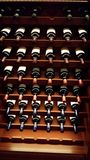 Wine rack with bottles reflecting beads of light. Stock Photography