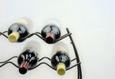 Wine on rack presented on plain white background. Royalty Free Stock Image