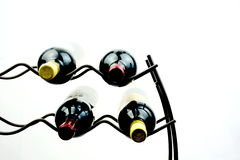 Wine on rack presented on plain white background. Royalty Free Stock Photography
