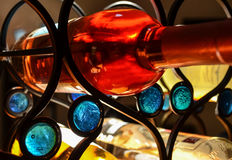 Wine Rack. Red wine, white wine and alcohol on a black metal wine rack Royalty Free Stock Photo
