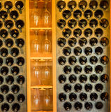 Wine in rack in tasting room. Bottles of wine and wine glasses on display in a tasting room of a boutique winery in southern Oregon stock photos