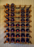 Wine in rack in tasting room. Bottles of wine and wine glasses on display in a tasting room of a boutique winery in southern Oregon Royalty Free Stock Photo