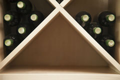 Wine rack with wine bottles. Stock Photo