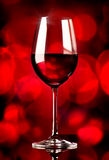 Wine on red background Royalty Free Stock Photography