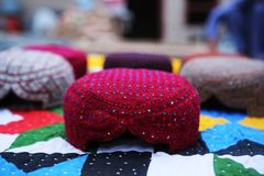 Wine red coloured Sindhi topi skull cap. Handmade in a village in Tharparkar, Sindh. The woollen material is interlaced with colourful beads Royalty Free Stock Image
