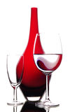 Wine and red glass vase in art composition Stock Photos