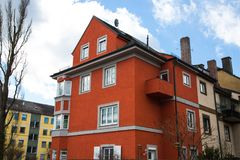 Wine red multi-family house in Germany,. Living Stock Photo