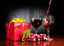 Wine and red present Royalty Free Stock Photos
