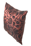 Wine-red silk pillow with black ornaments. On white background for designers Royalty Free Stock Photo