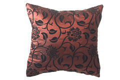 Wine-red silk pillow with black ornaments Royalty Free Stock Image