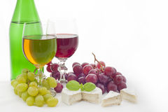 Wine red ,white grapes and cheese Royalty Free Stock Image