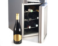 Wine refrigerator and bottle of red wine. Royalty Free Stock Photo