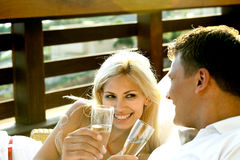 Wine in the resort. Couple having wine in the resort Royalty Free Stock Images