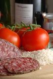 Wine rice and tomatoes Stock Images