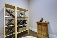 Wine room with wooden wine racks and wine tasting table. Royalty Free Stock Image