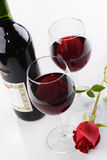 Wine and a rose Royalty Free Stock Images